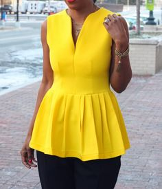 Peplum top made with bright yellow wool from Mood Fabrics.