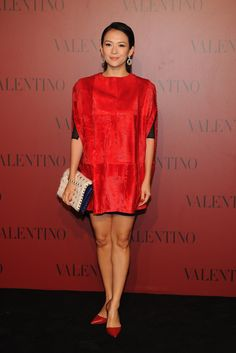 Zhang Ziyi is carrying a Valentino Garavani bag from the Fall Winter 13/14 collection and wearing Valentino Garavani shoes from the Fall Winter 13/14 collection and a cape from the Fall 2013 collection