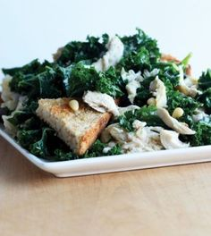 Kale Chicken Caesar Salad - Kale puts a new spin on your classic caesar salad, with a lightened-up (but equally garlicky!) dressing and ample protein to boot.