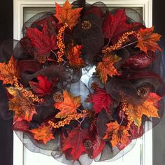 Fall deco mesh wreath like this one, it's more classic looking and not so childish cartoon looking than most deco mesh.