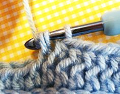 Looking to add a little excitement to your Half Double Crochet stitches? Look no further than this VERY simple variation on the HDC! All it takes is inserting your hook into a different loop than usual to come up with this beautiful, faux knit pattern.  Now, there may be a technical abbreviation f
