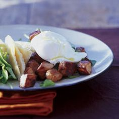 Crisp bacon and poached egg salad with warm orange dressing