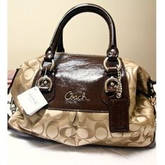 My new Coach purse & wallet.,fashion coach don't click on the link.  The pic is my new bag