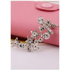Silver Rhinestone Star Decor Stylish Ear Cuff (785 RSD) ❤ liked on Polyvore featuring jewelry, earrings, silver, silver jewelry, silver jewellery, ear cuff jewelry, silver star jewelry and rhinestone earrings