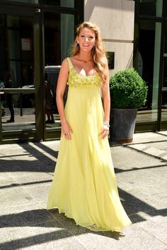 June 20, 2016 The actress matches the weather in a sunny yellow gown by Jenny Packham.