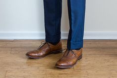 A complete guide to men's pant length. Includes advice on where dress pants should fall, proper break in pants, photos of no break, medium break, full break