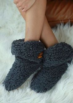 Winter cozy, indoor slippers - Button Closure. . . because you need them ! Sizing; S/M Shoe Size 5-8, L/XL Shoe Size 8-10 100% Polyester