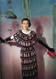 Dorian Leigh wearing a dress by Traina-Norell, 1946