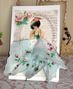 Our lovely hankie card has a elegant Victorian lady holding a fan and is wearing a real sweet floral hanky! Great for any occasion. card comes in a clear sleeve and includes envelope. Card is 5 x Decoupage, Dress Card, Vintage Handkerchiefs, Mothers Day Cards, Vintage Crafts, Scrapbook Cards, Scrapbooking, Craft Fairs, Paper Dolls