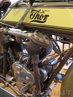 1918 Thor Motorcycle | The Thor was made by the Aurora Machine & Tool Co. in Chicago, Illinois. They made teh first engines for Indian in 1902 and then started their own line in 1903. The 1200cc motor in this bike was only made until 1915 but Thor assembled bikes up to 1918. Several thousand were built. Aurora also made home appliances and at one time sold a combination clothes/dishwasher, which probably speeded up their eventual demise. | Solvang Motorcycle Museum…
