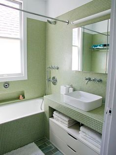 Not typically a fan of all-tile bathrooms, but I love this look