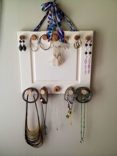 Made a jewelry holder out of an old desk cabinet door and wine corks #DIY