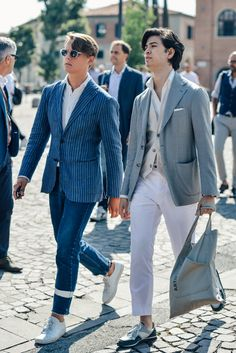 for guy on left like the white stripe in his jean right leg, that is interesting. But overall I like the dress of the guy on right with the sport casual shoes against the layered blazer, it just works.