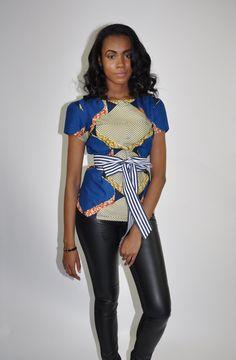 THE AVA TOP# 10020PRODUCT DESCRIPTIONFeatures: •modern clean cut  •feminine hemline •short sleeve •bold print •zipper closure•hits jus...