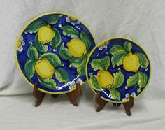 Brightly colored hand painted ceramic plates look beautiful handing on the wall- put together a unique set of 3