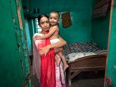 Labone, aged 27, who works at a brothel in Jessore, Bangladesh with her daughter who was fathered by a client. All the money she earns is given to her madam.