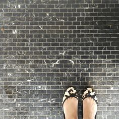 Love this mini brick black marble tile out. A luxe flooring choice for the entry of one of our fave cafes. See what other ideas there are to steal from cool cafes here >>