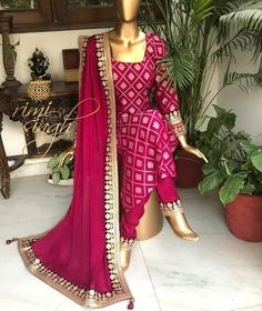 Deep plum pure banarasi muga silk kurta paired with a cotton silk churidaar and a matching chinnon chiffon dupatta. Available exclusively at Rimi Singh Studio A 999 Sushant Lok 1 Gurgaon Pakistani Dresses, Indian Dresses, Indian Outfits, Indian Attire, Indian Wear, Stylish Dresses, Fashion Dresses, Stylish Suit, Indian Designer Suits