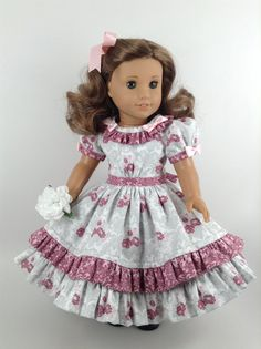 Handmade dress and petticoat for American Girl and other similar 18-inch dolls.  Lots of ruffles on this very feminine 1800s historical floral