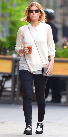 Kate Mara worked the menswear trend, layering a crisp button-down under an ivory sweater and styling both with black skinnies and two-tone brogues. A pretty chained cross-body clutch completed her look.