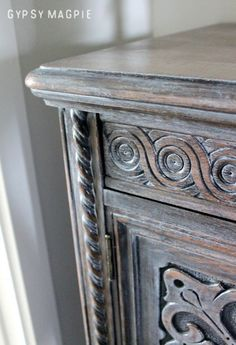 Can't get enough of this rescued cabinet by Gypsy-Magpie! Can you believe this piece was destined for the trash? It was first given a coat of GF Antique Walnut Gel Stain then topped with Winter White Glaze Effects to make all those details pop!
