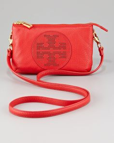 """While it's small in size, the Tory Burch Kipp crossbody keeps you organized with two separate compartments and built-in credit card slots. In Tory Red Pebbled Leather and a Perforated Double-T Logo at Front Center this will become your """"Go To"""" Crossbody for Every Occasion. Other Features include:..."""