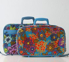 Retro Mod Suitcases - I used to have a suitcase similar to this when I was a kid. A squirrel chewed it's way through the vinyl into the zip pocket and stole my granola bars when I took it to camp. Later it's where mom stored the dress ups. I miss my tacky suitcase.