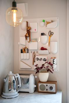 House Tour: A Clean & Colorful Oslo Townhome Wall Pocket Organizer, Industrial Style Kitchen, Funky Home Decor, Kitchen Corner, Wall Organization, Retro Home, House Tours, Townhouse, Home And Family