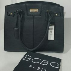 """❌SOLD❌✴BCBG Paris Black Faux Leather Handbag✴ Gorgeous brand new with tags black BCBG Paris handbag. Gold tone hardware with dust bag.   Measures 14.5"""" wide and 12"""" tall. Strap drop is about 9"""".   Zipper in the middle inside, two pocket openings, another zipper against the inside back. Closes with two snap buttons.   Retails for  $120  ❌No trades. ➡If you want to make an offer please use the offer button.  ➡If you have any questions please ask. BCBG Bags"""
