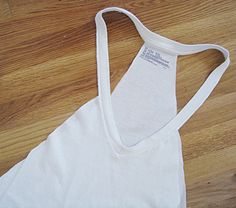 Swimsuit cover using a man's oversized v-neck  I'd also wear it with a bandeau