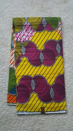 Green Yellow  and Purple Vlisco African Fabric Hollandais  by the 6 yards by HouseofuBuhleColl on Etsy https://www.etsy.com/listing/523128532/green-yellow-and-purple-vlisco-african