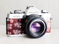 Minolta XG 1 - MINT Condition functional vintage 35mm SLR camera for lomography, 50mm 1.7 prime lens, Bavarian folk motifs, New Lightseals! by FolkCamera on Etsy https://www.etsy.com/listing/288644263/minolta-xg-1-mint-condition-functional