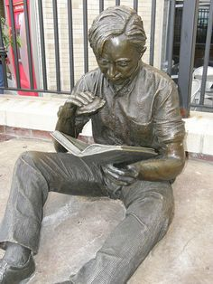 Out to Lunch on Country Club Plaza in Kansas City, MO.  A life-size bronze by J. Seward Johnson, Jr. depicts a young man sitting on a large rock, reading a book and holding an all-American hamburger. Out to Lunch was completed in 1977.