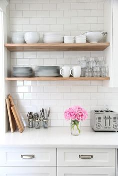 Use this idea for shelves between dining room and refrigerator. We saved money using a standard 3x6 white subway tile from Home Depot. Even though our backsplash tile choice was cheap, it's still a classic look and I really love the way it looks all the way up to to the ceiling behind the open shelves, and around the kitchen window. I also really love the light grey grout we selected. It is subtle, but really makes the tile a feature in the kitchen.