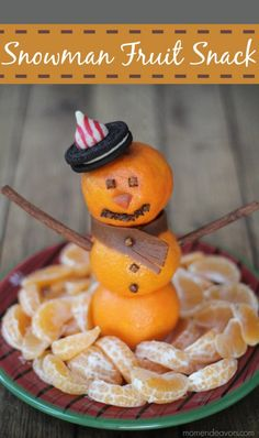 Snowman made from oranges. Great for kid Christmas party.