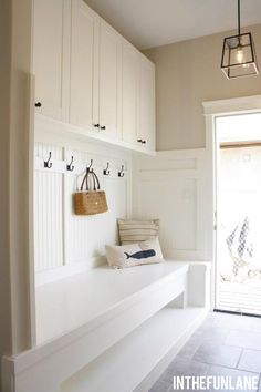 Mud room bench & hooks with cupboards above