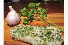 This cod recipe will also work with any firm white fish. 1-1/2 lb (700 g) cod fillets (about 1-inch thick at top), cut into 4 pieces About 2 tbsp extra-virgin olive oil Sea salt + freshly ground pepper to taste 1/4 cup panko breadcrumbs 2 large cloves garlic, pressed or minced 1/4 cup finely chopped parsley 4 tsp unsalted butter, cut into 12 small cubes