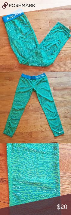 Green and Blue Nike Pro Capris Size Medium Green and blue animal print Nike Pro yoga capris Size medium  Soft and light weight material, has good stretch.  No damage or worn spots.  Perfect for the gym. Nike Pants Leggings