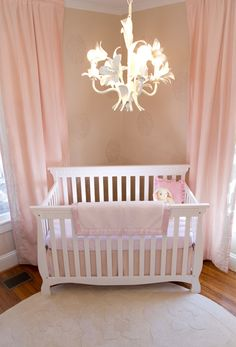 Like the crib in the corner w/ chandelier ... and the stencils on the walls... and pink :)