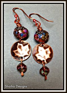 Gorgeous artisan earrings complete with all the varied colors of the falling leaves.  Ingredients:  Lampwork beads from StudioJuls, brass discs from Metapolies, Czech glass, Copper earwires  http://shaihadesigns.storenvy.com/collections/914373-earrings/products/10714482-autumn-splendor-earrings