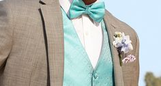 Add a pop of color behind a classic light grey tux for a festive, spring look.