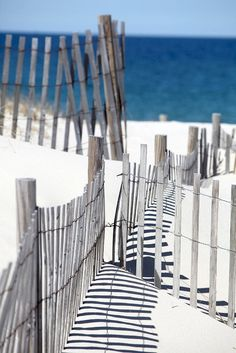 This could be inspiration for a great beach house: bleached wood, sand/sky blue/sea blue palate, shabby chic stripes