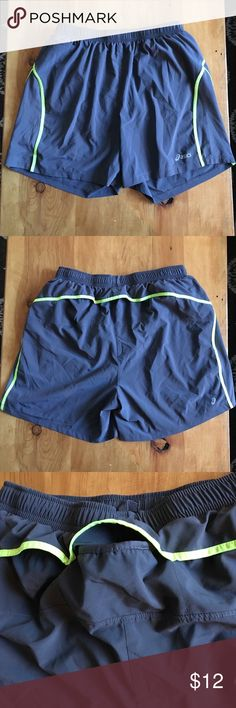 "Asics Mens 7"" Running Shorts Asics mens 7"" running shorts, size medium. Excellent condition, barely worn. The perfect in-between length for runners who still want thigh coverage. 89% polyester, 11% spandex. Gray with electric yellow detail. Last two photos are a truer representation of the color. Asics Shorts Athletic"
