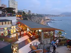 Along the seawalk in the Miraflores district is Larcomar, a multilevel entertainment, food&shopping megacomplex. The 1st thing you'll notice about Larcomar is that you cannot see it. The entire complex is built into the cliffside, underneath Miraflores — the entrance is on Block 6 of Malecón de la Reserva, across the street from the JW Marriott hotel; take the stairs down just before you get to the cliff's edge. Pick a restaurant &  watch the sun set on the Pacific.