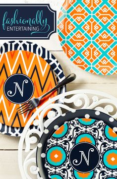 Monogrammed plates in coordinated colors and patterns. Lattice & Ivy
