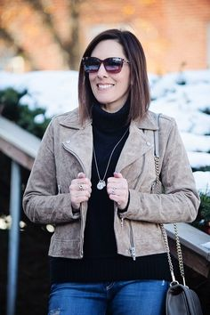 BlankNYC suede moto jacket in Midnight Toker over black turtleneck for a chic street style winter outfit.