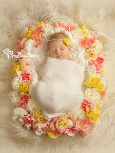 newborn baby with pink yellow flowers sleeping greensboro burlington nc photographer