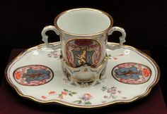 File:Chocolate cup and trembleuse stand with a Cardinal's coat-of-arms, c. 1735, Du Paquier factory, hard-paste porcelain, overglaze enamels...