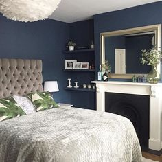 Farrow and Ball stiffkey blue bedroom, white Victorian fireplace, gold mirror, feather lamp, button grey headboard Blue And Gold Bedroom, Blue Master Bedroom, Woman Bedroom, Bedroom Green, White Bedroom, Bedroom Colors, Mirror Bedroom, Blue Gold, Blue Bedrooms