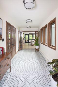 Herringbone Tile Pattern, Chevron Tile, Entryway Tile Floor, Planchers En Chevrons, Fireclay Tile, Bathroom Tile Designs, Bathroom Ideas, Tile Trim, Black And White Tiles